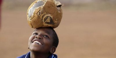 ORG XMIT: XLB107 A South African kid, using a ragged ball, plays soccer in Thokoza, on the outskirts of Johannesburg, South Africa, Thursday, July 1, 2010. (AP Photo/Luca Bruno)